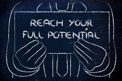 Business man holding sign saying Reach your full potential. Reach your full potential, sign in the hands of a business man royalty free stock photos