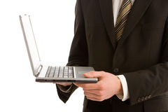 A business man holding a silver laptop Royalty Free Stock Images