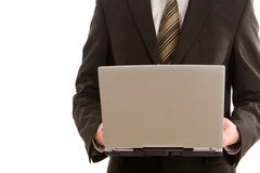 A business man holding a silver laptop Stock Image
