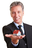 Business man holding small house Royalty Free Stock Photo