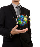 Business man holding the small world of social network Royalty Free Stock Image