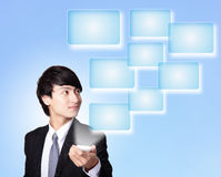 Business man holding smart phone with empty screen Royalty Free Stock Photos