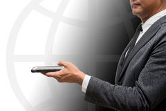 Business man holding smart phone with globe graphic in backgroun Stock Images
