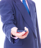 Business man holding smart phone isolated Stock Photography