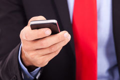 Business man holding smartphone Stock Photography
