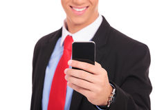 Business man holding smartphone Royalty Free Stock Photos