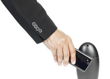 Business man holding smartphone as NFC Royalty Free Stock Photo