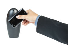 Business man holding smartphone as NFC royalty free stock image