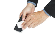 business man holding smartphone as NFC - Near field communication concept royalty free stock images