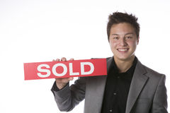 Business man holding a SOLD sign Stock Photography
