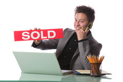 Business man holding a SOLD sign Stock Photo