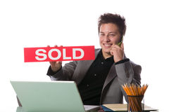 Business man holding a SOLD sign Stock Photos