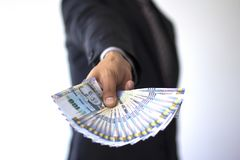 Business man holding 100 soles bills in a fan, peruvian currency concept stock image