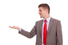 Business man holding something in hand Stock Image