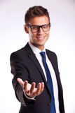 Business man holding something on his hand Royalty Free Stock Image