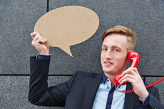Business man holding speech bubble Stock Images