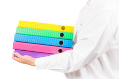 Business man holding stack of colorful folder Royalty Free Stock Images