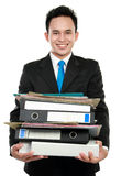Business man holding stack of files and folders Stock Images
