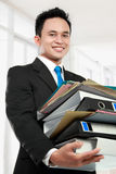 Business man holding stack of files and folders Stock Image