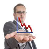Business man holding stock graph. Business man reaches out his arm with a stock exchange graph going downwards  floating over his hand. Isolated on White Stock Photos