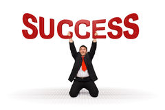 Business man holding success text Royalty Free Stock Image