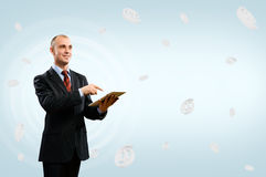 Business man holding a table Stock Images