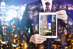 Business man holding tablet on blurry background. Royalty Free Stock Photo