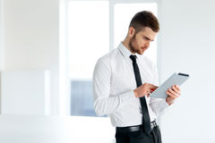 Business Man Holding a Tablet Computer. Royalty Free Stock Photos