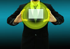 Business man holding  tablet computer Royalty Free Stock Photo