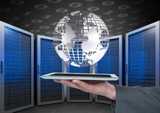 Business man holding a tablet and graphics in server room Royalty Free Stock Images