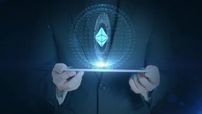 Business man holding tablet hologramm hud projection ethereum cryptocurrency icon