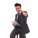 Business man holding tablet and making the ok sign Stock Images