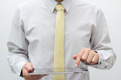 Business man holding tablet PC Royalty Free Stock Photo