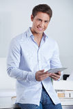 Business man holding tablet PC Royalty Free Stock Images