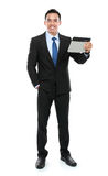 Business man holding a tablet PC Stock Photo