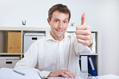 Business man holding thumbs up Stock Images