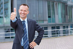 Business man holding thumbs up Stock Photo