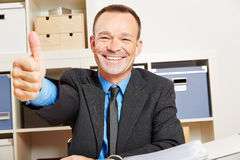 Business man holding thumbs up Royalty Free Stock Image