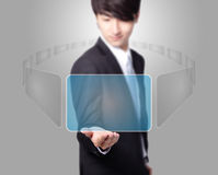 Business man holding a touch screen Royalty Free Stock Images