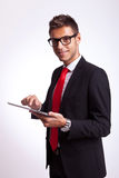 Business man holding a touch screen pad Royalty Free Stock Photography