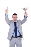 Business man holding a trophy Stock Photo
