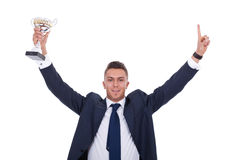 Business man holding a trophy Stock Photos