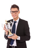 Business man holding a trophy Royalty Free Stock Photos
