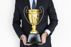 Business Man Holding Trophy with both hand Royalty Free Stock Photo