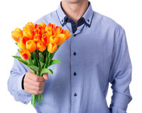 Business man holding tulip flowers isolated on white Royalty Free Stock Photo
