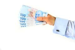 Business man holding turkish lira Royalty Free Stock Images
