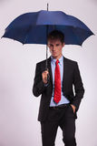 Business man holding umbrella Stock Photography