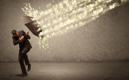 Business man holding umbrella against dollar rain concept Royalty Free Stock Photography