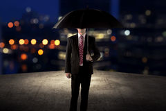 Business man holding umbrella standing on the rooftop Royalty Free Stock Photography