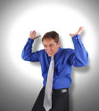 Business Man Holding Up Stress Weight Stock Photography